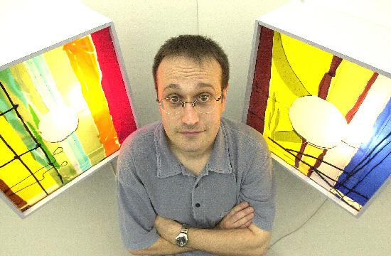 York College tutor Ed Poxon, pictured by The Press in 2001 with cast glass displays by a student
