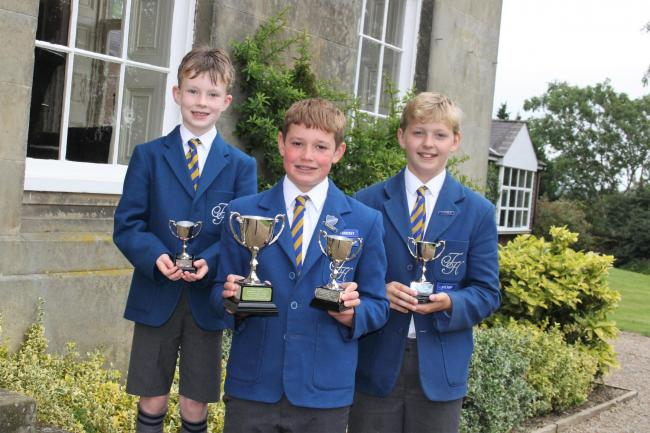 Terrington Hall School's cricket captains, from left, Michael Mulryne (U9), Thomas Easterby (U13) and Rollo Storey (U11) with their match trophies and the Storey Cup, second from left