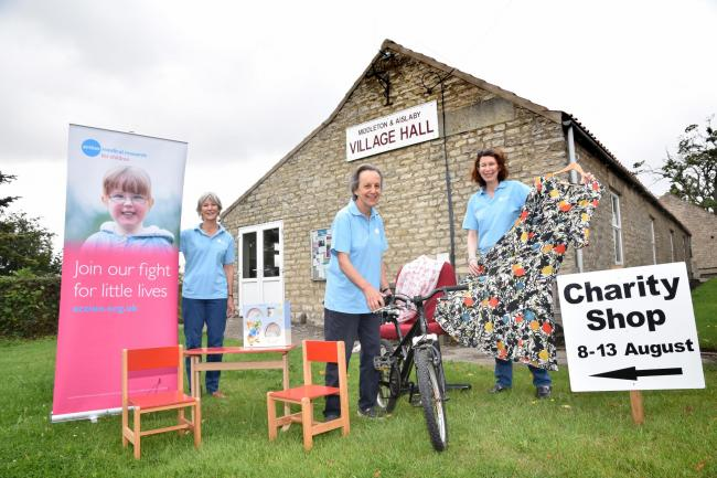 Committee members Janie Dudley-Smith, Sarah-Jane Voelcker and Susie Taylor prepare for their Ryedale Action Medical Research charity shop at Middleton Village Hall    Picture: Frank Dwyer