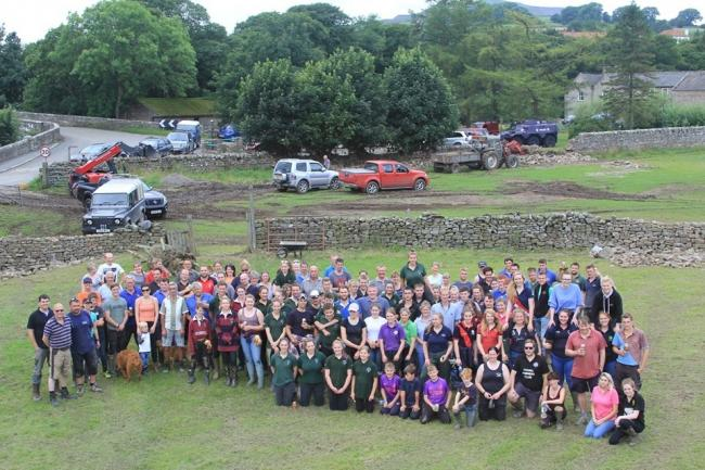 Young farmers help clear up flood damage volunteers in the Yorkshire Dales