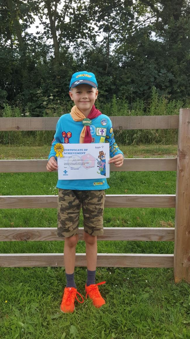 Jack Simms,  who attends 1st Helmsley Beavers, now proudly wears all 22 Activity badges on his blue jumper