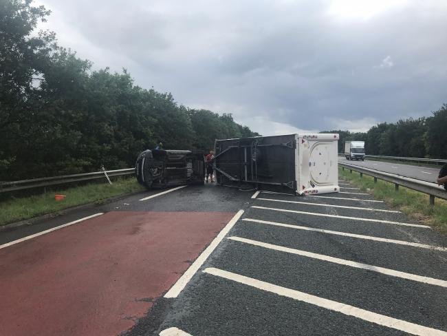 The overturned caravan on the A64 near Malton   Picture: North Yorkshire Police Roads Policing Group