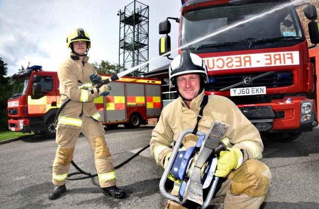 Firefighters Jez Wilson, left, and Adam Hall, from Blue Watch at Malton Fire Station, look forward to their open day this weekend     Picture: Frank Dwyer
