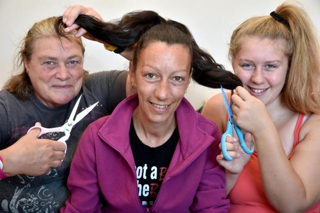 Cheryl Steel, from Norton, pictured back in September, with mum Mandy Cass and niece Jade Cass before the charity head shave  Picture: Frank Dwyer