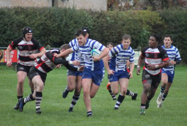 Malton & Norton attempt to stop a midfield break by Pocklington man of the match Jonty Peters. Picture: Pocklington RUFC