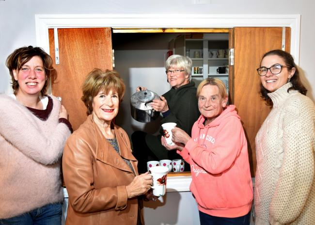 Volunteers get ready to open Norton Free Fridge, from left, Row Metcalfe, Hazel Chapman, Barbara Machin, Pat Dexter and Molly Keal   Picture: Frank Dwyer