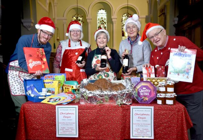 Volunteers prepare for this year's St Michael's Church Christmas fair, which takes place on Saturday. From left, Andrew Nicholson, Caroline Nicholson, Anne Bell, Rosie Miller and David White   Picture: Frank Dwyer