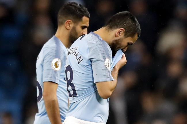 Ilkay Gundogan (right) still believes Manchester City can win the title