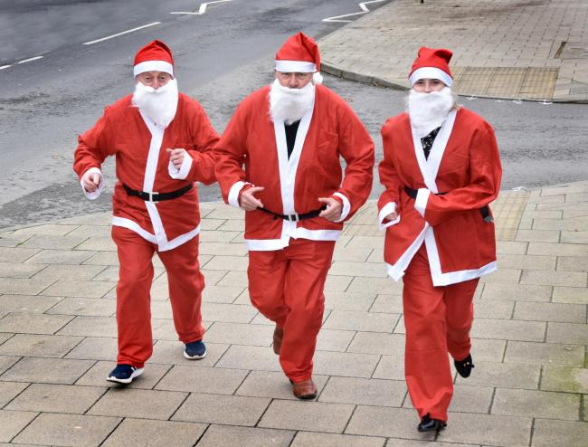 (l-r), Rob Davies , Councillor Ray King and Megan Rice  prepare for the annual Norton Santa Run   Picture Frank Dwyer.