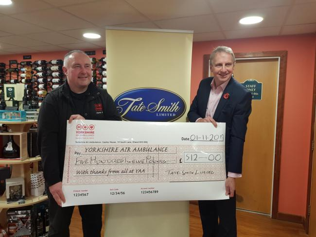 Paul Tate-Smith from Tate-Smith Ltd in Malton presents a cheque to Kevin Hutchinson from the Yorkshire Air Ambulance following a golf day