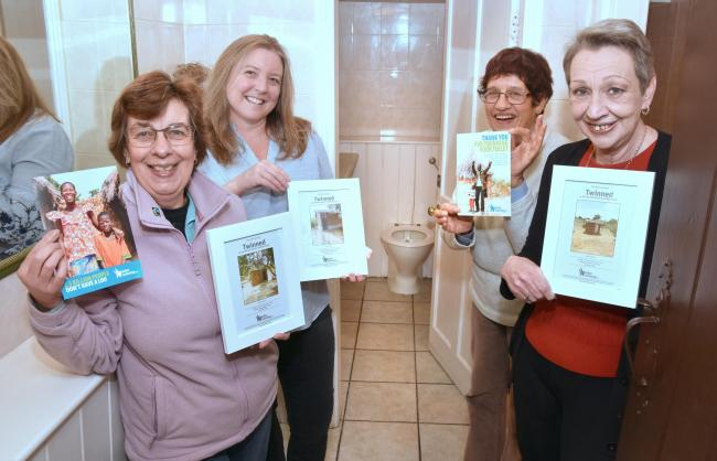 Promoting the 'toilet twinning' project at the Blue Ball are Malton and Norton Fairtrade members Helen Morgan, left, and Janice Gwilliam, second right, along with Lisa Bruce, second left, from the Rose & Crown and Chris Clayton, right, fro