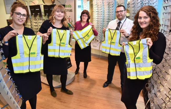 Staff from Specsavers with the high-vis jackets ready to hand-out. From left, Katie McKie, Hanni Hughes, Maureen Nash, Adam Cross and Simone Stephenson   Picture: Frank Dwyer