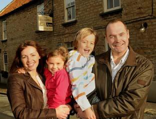 Mark and Jane Scholefield with their children Jessica, five, and Will, eight, outside the Blacksmith's Arms in Westow.
