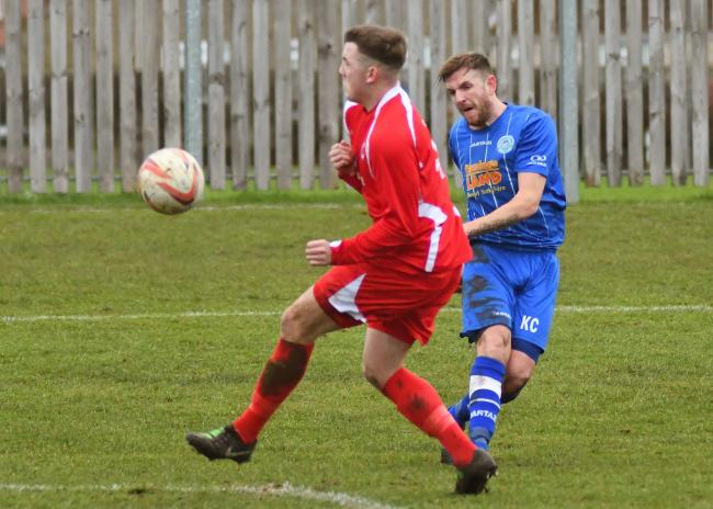 Pickering Town v Parkgate. Pictured is Pickering's Ryan Cooper watches his shot curl into the goal. Picture David Harrison.