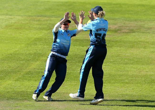 York-born Yorkshire batswoman Lauren Winfield (right), with Gwen Davies (left), celebrates taking a wicket against Western Storm. Picture: Mark Kerton/PA Wire