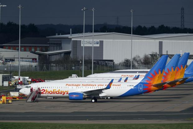 Gazette & Herald: AIRLINE: Several Jet2 planes have been parked up at Birmingham Airport during the pandemic. Picture: Steve Parsons/PA
