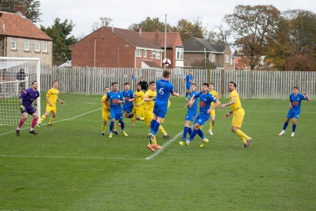 Pickering Town defender Ben Clappison wins a header against Trafford. Picture: Jack Roberts/Pickering Town
