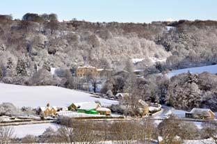 Gazette & Herald: Looking down on a wintry scene of Hackness Village and Hall.