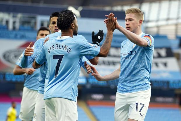 Manchester City's Raheem Sterling (left) celebrates scoring the opening goal against Fulham