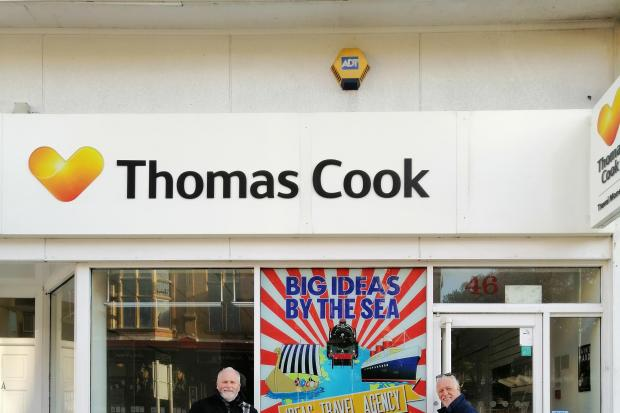 Kane Cunningham and John Oxley outside the old Thomas Cook shop in Scarborough