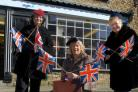 Vienna Johnson, Maureen Rolph and Sheila Dennis from Age UK in Kirkbymoorside get ready for Pickering War Weekend by  getting dressed up in some of the 1940s clothes on sale in the shop