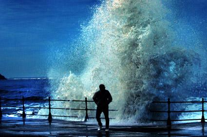 A dramatic scene on the sea-front at Scarborough as huge waves crashed against the sea wall during high winds.