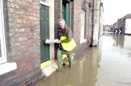 Mike Williams of Castle News in Castlegate, Malton, pictured delivering the news to residents.