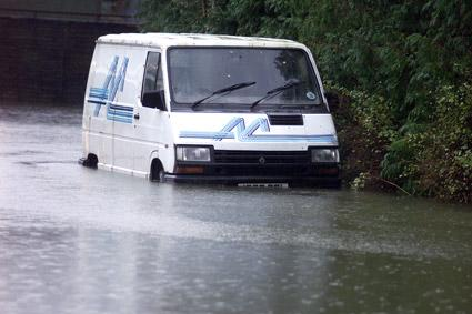 A van under water at Electrodiesel on Scarborough Road, Norton.