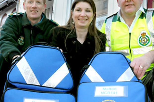 Gazette & Herald reporter Karen Darley with community defibrillation officer Neil Marsay, left, and First Responder Chris Speedie, and the new kit bought by the Pulse Appeal