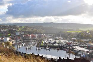 Gazette & Herald: Whitby Harbour and the River Esk with the Golden Grove in the distance.