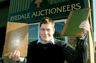 Angus Ashworth, of  Ryedale Auctioneers, with the two 17th century books which will be  auctioned  next month