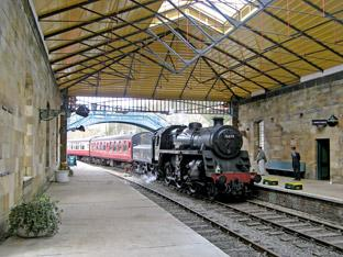 Engine 76079 arrives at the new- look Pickering Station