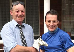 'Monty' Hempton, left, receives a memento from ace jockey Kieren Fallon after the Monty Hempton – A Lifetime In Racing – Fillies Handicap