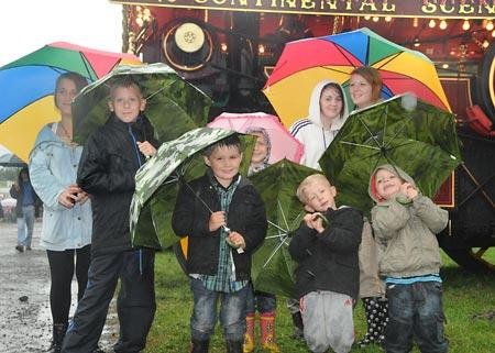 Members of the Hammond family enjoy the show despite the downpour