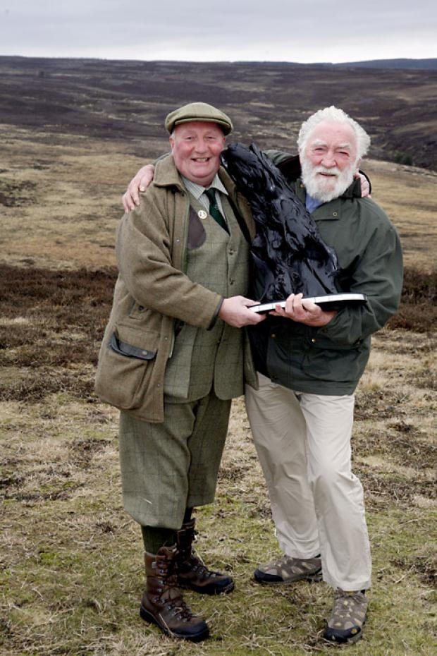George Thompson, head gamekeeper for Spaunton Moor, receives his 2011 Bellamy Trophy organised by the National Gamekeepers' Organisation Educational Trust, from Prof David Bellamy