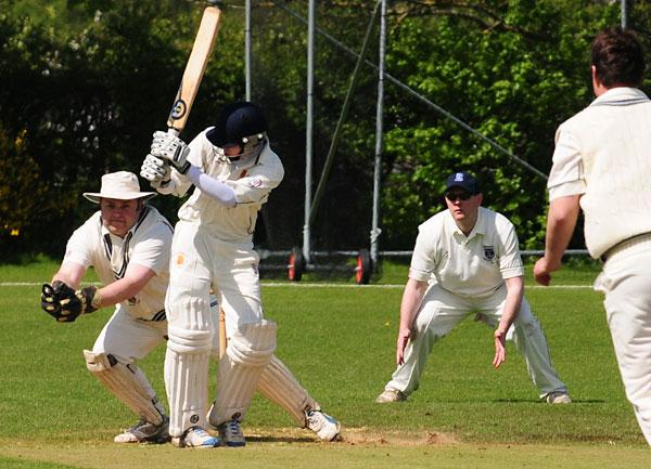 Heworth wicket-keeper Mark Lynch takes a ball down the leg side, after Acomb  batsman Matt Dale misses a delivery from Richard Bowling