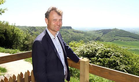 Comedian Hugh Dennis enjoys the view over Sutton Bank during his visit to the National Park visitor centre