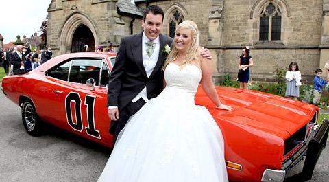 Charlotte England and Craig Mead with their Dodge Charger which was one of just a few to survive being smashed up in Dukes Of Hazzard