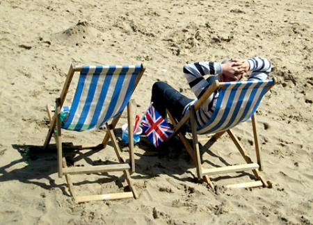 Deck chairs on the beach at Scarborough by Barbara Hudson