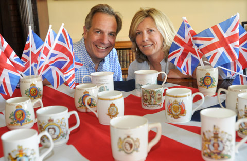 William and Marie Noelle Worsley with the collection of mugs at Hovingham Hall
