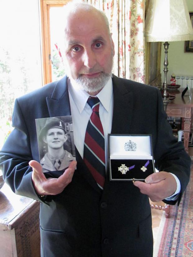 Rodney Wilson holds the Elizabeth Cross and a photograph of his brother, Edwin, who died in Korea in 1953 aged only 19