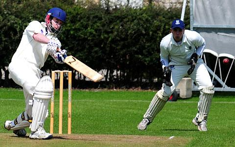 Pickering's Simon King drives a ball through the covers