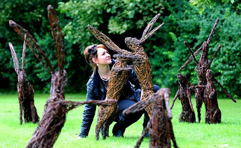 Emma Stothard with some of her willow hares