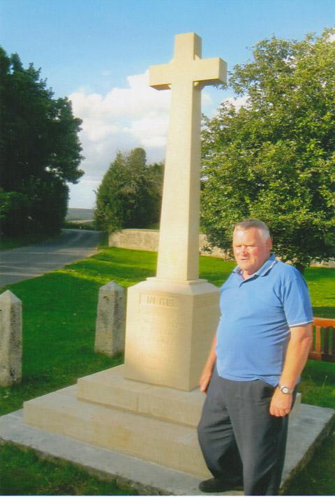 Hawson Simpson in front of the rebuilt war memorial