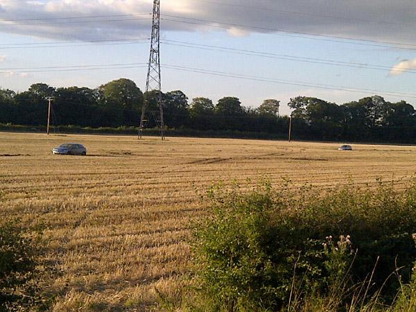 The two cars stuck in a field close to the A64 at Old Malton