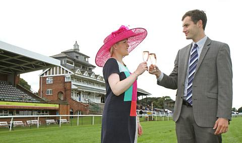 Sophia Monkman and Ben Atkinson toast Thirsk Racecourse's Ladies' Day