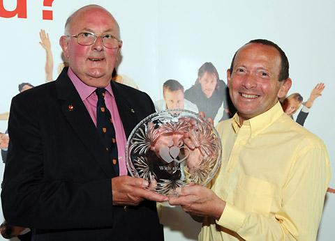 Robert Evans, left, receives his  award for giving blood 75 times from David Copes