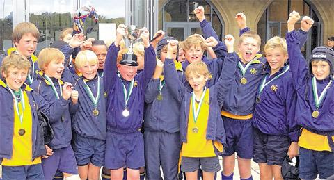Terrington Hall under-13s rugby union captain Charlie Tannahill holds aloft the trophy at Durham School's inaugural Parling Cup competition
