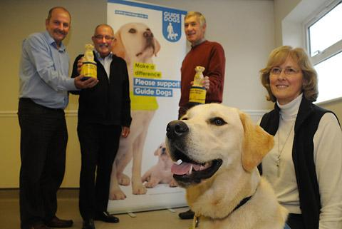 Thomas the trainee guide dog with, from the left, Chris Chapman and John Thomas from Thomas The Baker, and puppy walkers Keith and Hazel