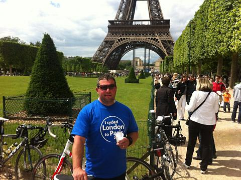 Malton plumber Phil Marwood enjoys a well-earned drink at the Eiffel Tower after his charity challenge